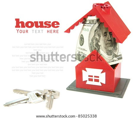 The toy house, money and keys. A place for your text. - stock photo