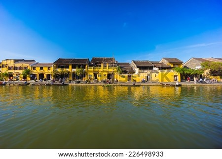 The traditional boat moored on the river in the ancient town of Hoi An, Vietnam. - stock photo