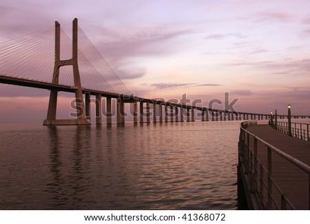 The traditional bridge over the river Tejo (Vasco da Gama - Portugal). - stock photo