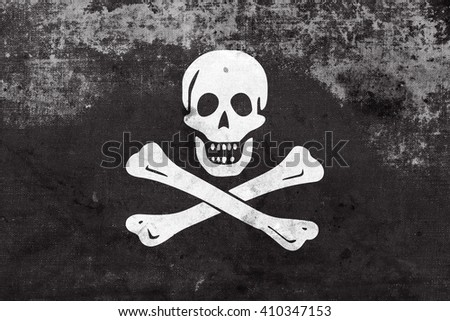 The traditional Jolly Roger of piracy Flag, with a vintage and old look - stock photo
