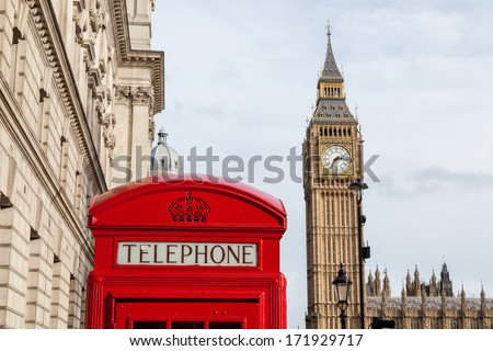 The traditional red telephone box and the Big Ben in London - stock photo