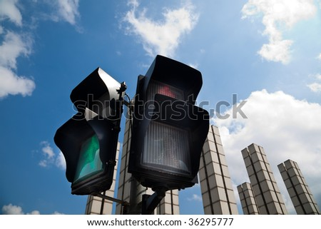 the traffic light with the blu sky background. - stock photo