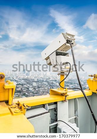 The traffic security camera on public bridge - stock photo