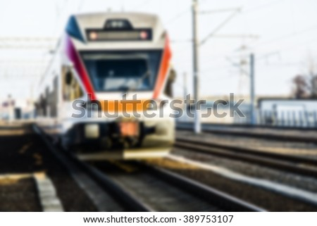The train arrives at the station. Intentionally blurred post production. - stock photo