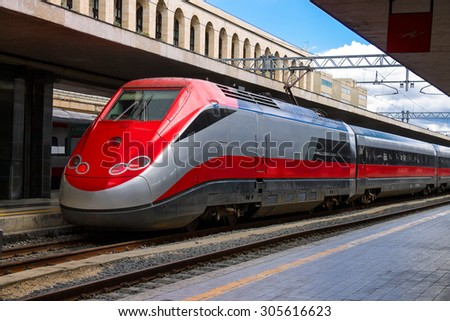 The train stops near the platform station in Italy - stock photo