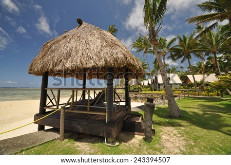 The tranquil beaches of the  South Pacific Ocean really are paradise found. This thatched beach hut overlooks the Coral Coast on the island of Viti Levu (Fiji) - stock photo