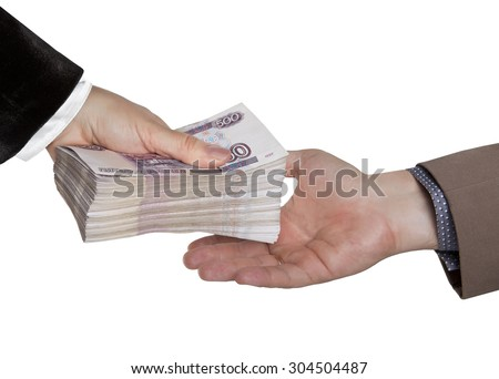 The transfer of money. Male and female hand with a big wad of Russian money. - stock photo