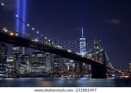 The Tribute in Light with Brooklyn bridge in New York City.  View from Dumbo, Brooklyn. - stock photo