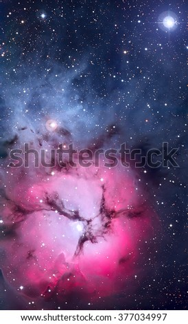 The Trifid Nebula is an H II region located in Sagittarius. An emission nebula, a reflection nebula and a dark nebula. Retouched colored image. Elements of this image furnished by NASA. - stock photo