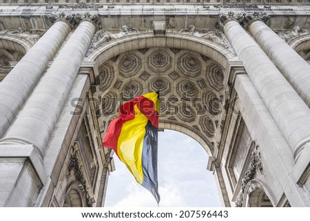 The Triumphal arch (Arc de Triomphe) in the Cinquantenaire park in Brussels, was planned for National Exhibition of 1880 to commemorate the 50th anniversary of the independence of Belgium. - stock photo