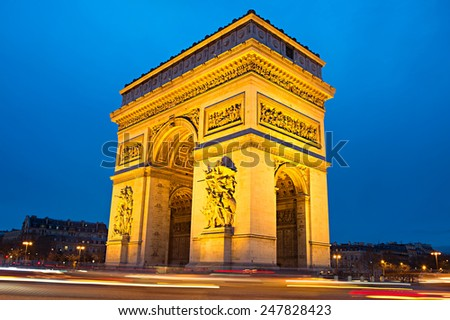 The Triumphal Arch (Arc de Triomphe) on Place Charles de Gaulle in Paris, France.  - stock photo