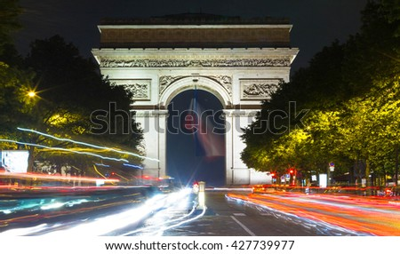The Triumphal Arch is one of the most famous monument in Paris.It honors those who fought and died for France. - stock photo
