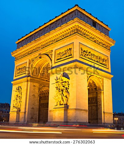 The Triumphal Arch  on Place Charles de Gaulle in Paris, France.  - stock photo