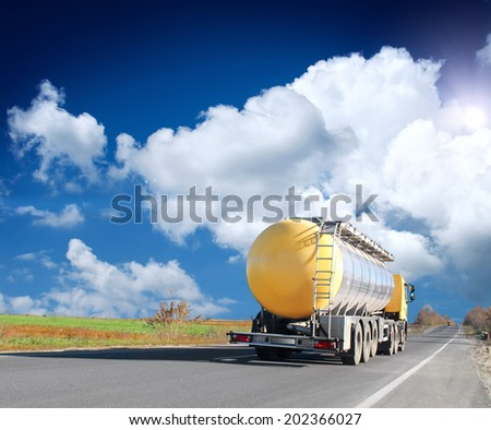 The truck and highway at sunset - stock photo