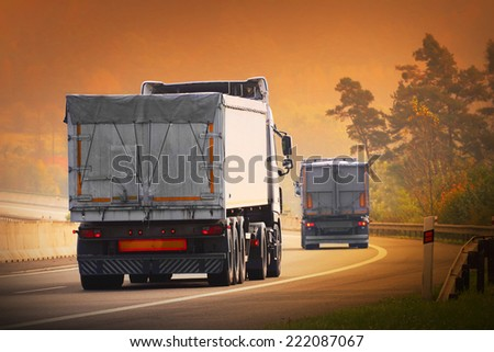 The trucks on a highway. - stock photo