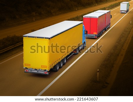 The trucks on the highway. - stock photo