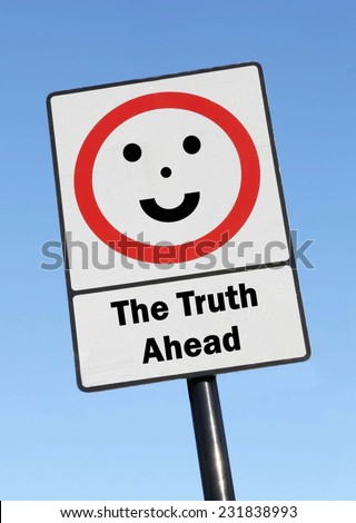 The Truth is ahead written on a road sign with a smiling face against a clear blue sky background - stock photo