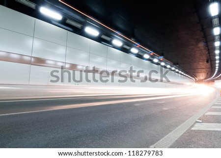 The tunnel at night, the lights formed a line. - stock photo