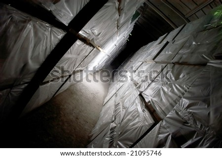 The tunnel from the goods in a warehouse - stock photo