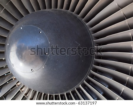 The turbine and blades of a jet engine. - stock photo