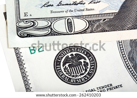 The twenty dollars (bill) banknote near seal of Federal Reserve System. Stacked macro photo. - stock photo