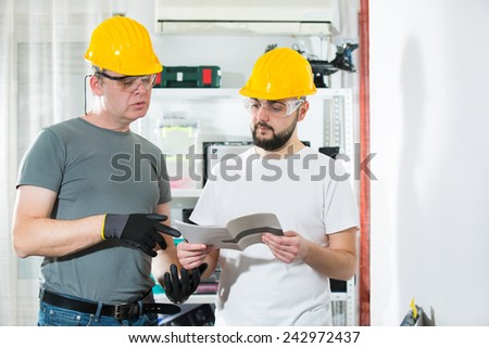 The two craftsmen working together - stock photo