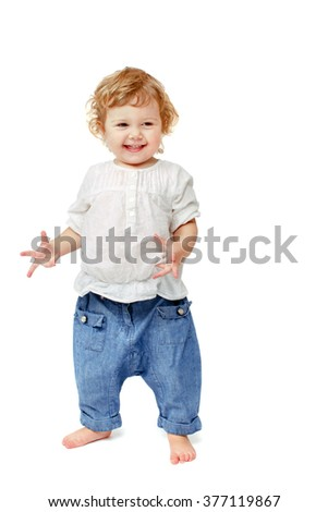 The two-year baby is happy and turns the wrists full body isolated white background - stock photo