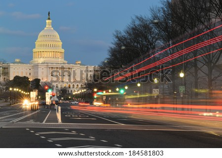 The U.S. Capitol building night view from from Pennsylvania Avenue with car lights trails - Washington DC, United States   - stock photo
