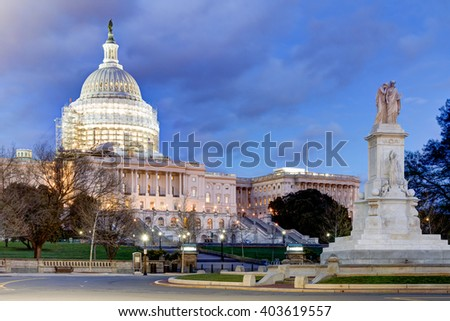 The U.S. Capitol Building with reduced scaffolding as a part of the Dome Restoration Project. The dome scaffolding has been partially dismantled. Also in the image is the Peace Circle. - stock photo