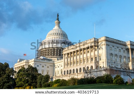 The U.S. Capitol Building with reduced scaffolding as a part of the Dome Restoration Project. The dome scaffolding has been partially dismantled. - stock photo