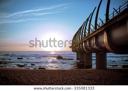 The Umhlanga Pier in durban South Africa In the Sunrise over Indian Ocean - stock photo