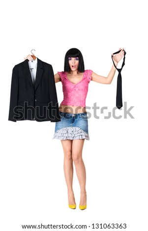 The uncertainty young woman chooses clothes isolated on white background - stock photo