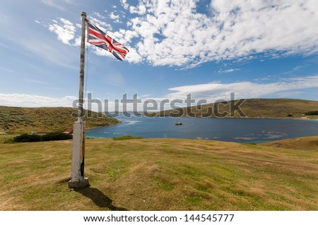 The Union Flag flies over the Falkland Islands demonstrating the island's allegiance to the UK. - stock photo