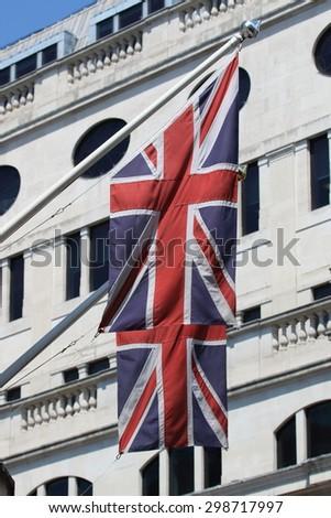 The Union Jack, the national flag of the United Kingdom waving on wind - stock photo