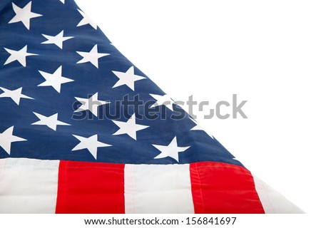 The United States flag, folded on a white background. - stock photo