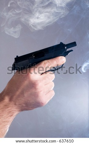 The unloaded pistol after shooting - stock photo