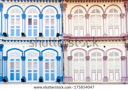 The upper levels of Singapore's Shophouses. - stock photo