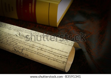 The US Constitution and a law book - stock photo