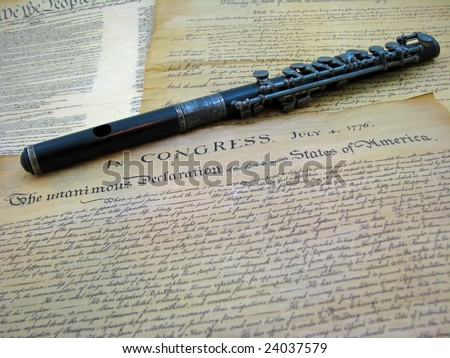The US Declaration of Independence with an antique piccolo (fife). - stock photo