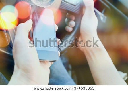 The use of mobile phones in the car. urban lifestyle concept.  - stock photo
