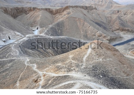 the Valley of the Kings in the desert at Thebes in Egypt - stock photo