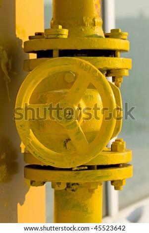 The valve of the yellow gas crane. - stock photo