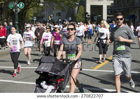 THE VANCOUVER SUN RUN, APRIL 19, 2015: Sponsored by Vancouver Sun newspaper, the 10-kilometer run is one of the largest road races in North America. Event is held yearly in April's Sunday since 1985.  - stock photo