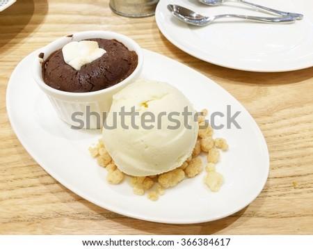 The vanilla ice-cream with lava chocolate cupcake. - stock photo