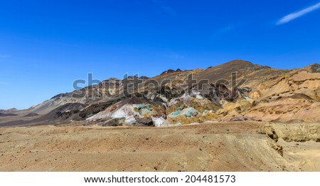 The variegated slopes of Artists Palette in Death Valley, California. Various mineral pigments have colored the volcanic deposits found here. - stock photo