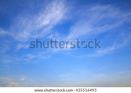 The vast blue sky and clouds sky.beautiful clouds sky and blur sky  .beautiful white fluffy clouds in the blue sky.blue sky sunset evening .color of blue sky at sunset or evening.  - stock photo