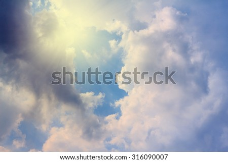 The vast blue sky and clouds sky with rays of sun. - stock photo