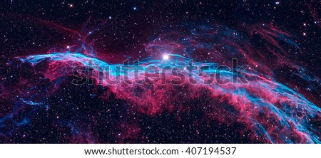 The Veil Nebula (The Witch's Broom Nebula) is a cloud of heated and ionized gas and dust in the constellation Cygnus. Retouched colored image. Elements of this image furnished by NASA. - stock photo