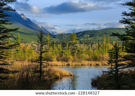The Vermilion Lakes are a series of lakes located immediately west of Banff, Alberta, in the Canadian Rocky Mountains. - stock photo