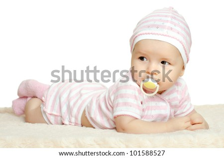 the very  beautiful  little baby  in pink dress, lie on stomach,  on white background, isolated - stock photo